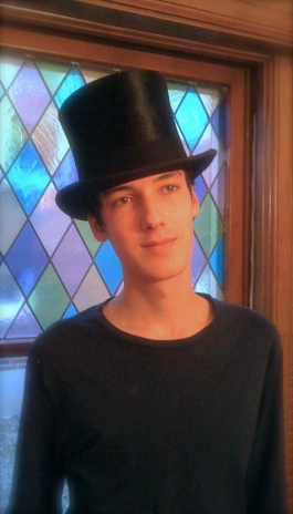 Joey Musial reluctantly models my top hat.