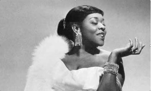 Jazz vocalist Dinah Washington, Queen of the Blues, was the most popular black female recording artist of the 1950s. She had a sultry, sexy voice.